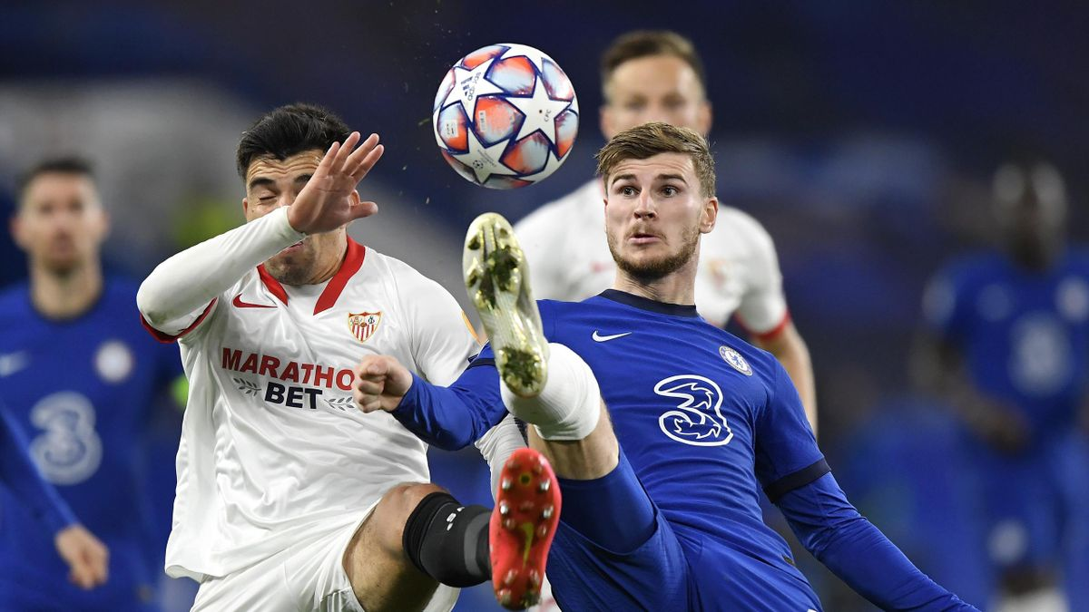 Timo Werner of Chelsea is put under pressure by Marcos Acuna of Sevilla during the UEFA Champions League Group E stage match between Chelsea FC and FC Sevilla at Stamford Bridge on October 20, 2020 in London, England