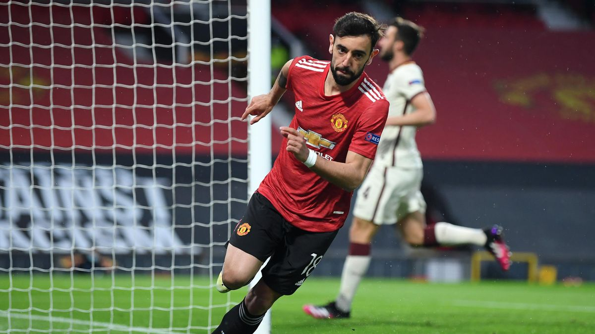 Bruno Fernandes of Manchester United celebrates after scoring their team's first goal during the UEFA Europa League Semi-final First Leg match between Manchester United and AS Roma at Old Trafford on April 29, 2021 in Manchester, England.
