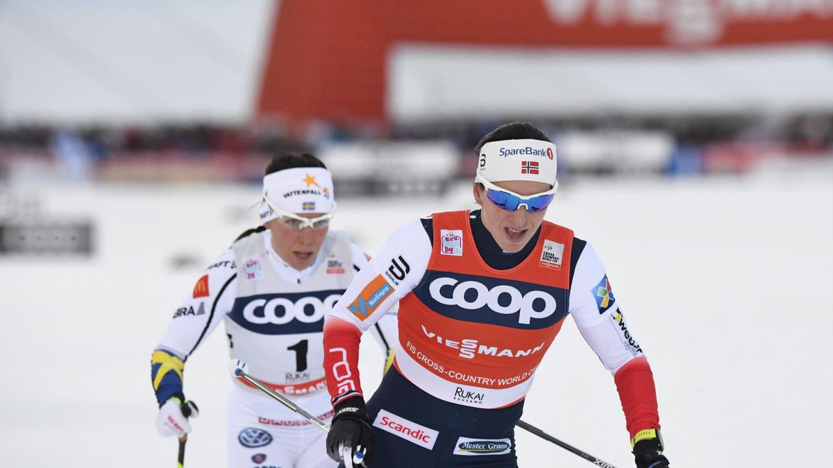 Marit Bjoergen (R) of Norway and Charlotte Kalla of Sweden compete in the Ladies' cross country skiing 10km free style pursuit competition of the FIS World Cup Ruka Nordic 2017 in Ruka, Kuusamo in northern Finland on November 26, 2017.