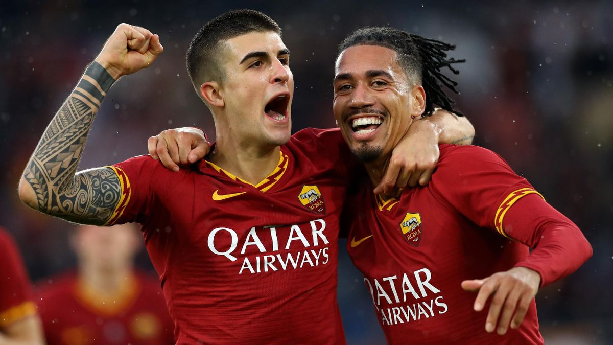 Gianluca Mancini of Roma celebrates with Chris Smalling of Roma after scoring the goal of 3-0 during the Serie A match AS Roma v Brescia Fc at the Olimpico Stadium in Rome, Italy on November 24, 2019