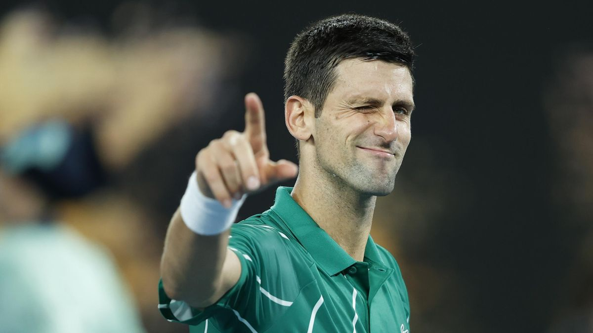 Novak Djokovic of Serbia celebrates winning match point during his Men's Singles first round match against Jan-Lennard Struff of Germany
