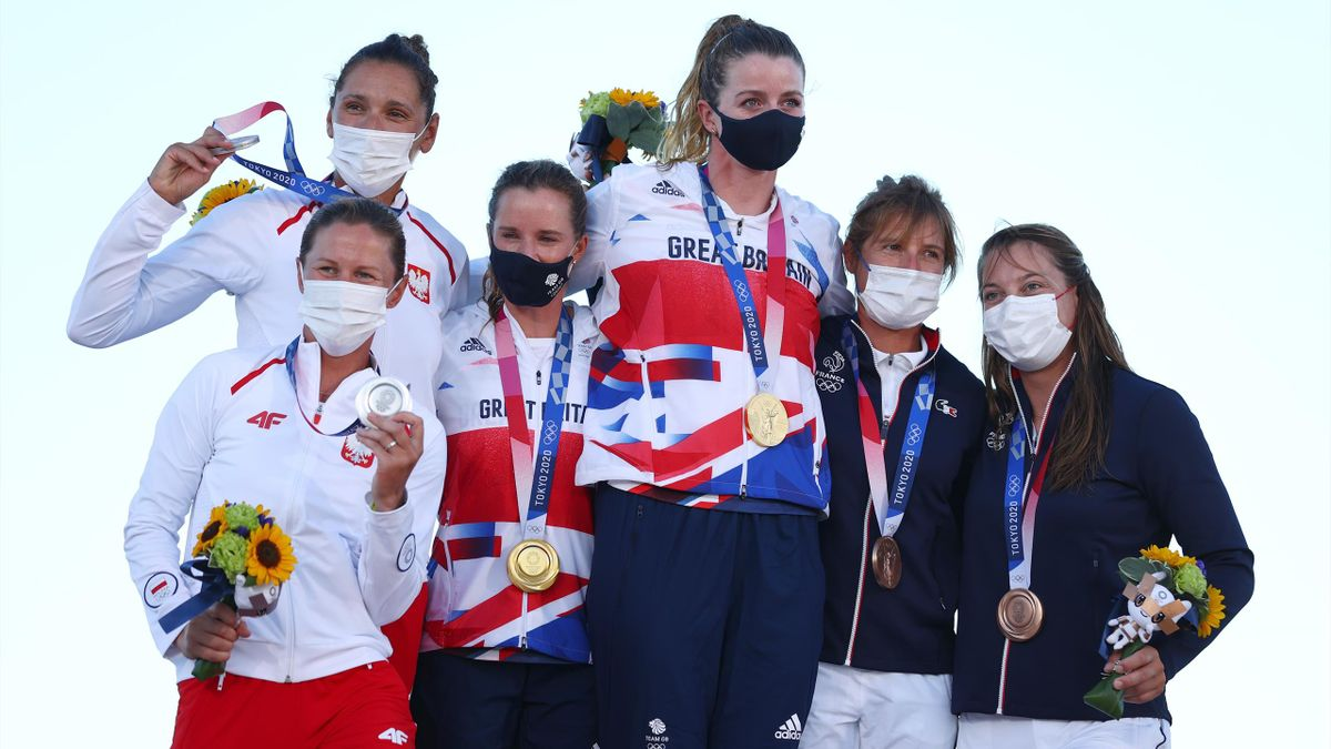 Silver medalists Agnieszka Skrzypulec and Jolanta Ogar of Team Poland, gold medalists Hannah Mills and Eilidh McIntyre of Team Great Britain, and bronze medalists Camille Lecointre and Aloise Retornaz of Team France pose with their medals for the Women's