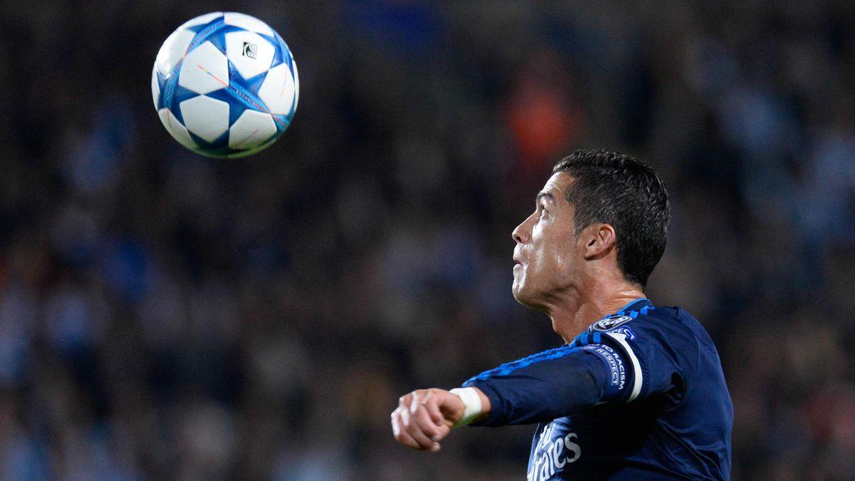 Cristiano Ronaldo watches the ball