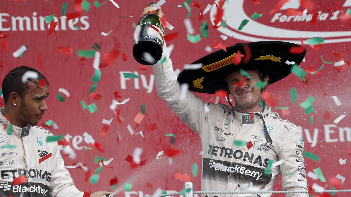 Lewis Hamilton soaks team-mate Nico Rosberg in Champagne after the Mexican Grand Prix