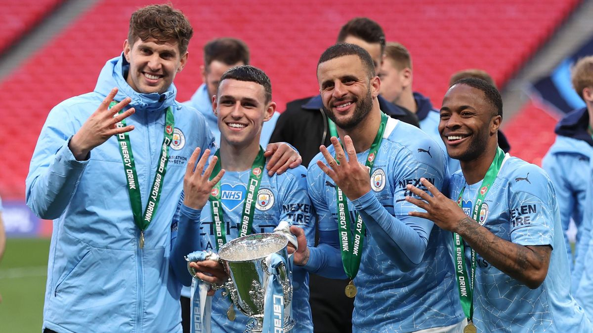 John Stones, Phil Foden, Kyle Walker and Raheem Sterling of Manchester City celebrates with the trophy after winning the Carabao Cup after the Carabao Cup Final between Manchester City and Tottenham Hotspur at Wembley Stadium on April 25, 2021 in London,