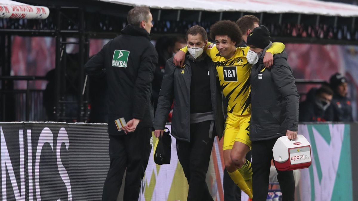 Dortmund's Belgian midfielder Axel Witsel leaves the pitch after being injured during the German first division Bundesliga football match RB Leipzig vs Borussia Dortmund in Leipzig, on January 9, 2021.