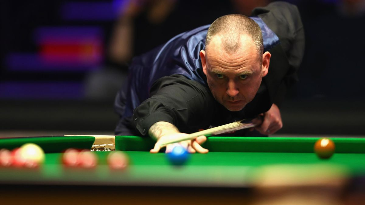 Mark Williams of Wales plays a shot during his match against Mark Selby of England.