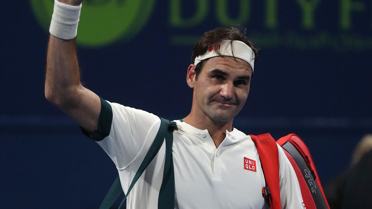 Roger Federer of Switzerland waves to the crowd after his defeat to Nikoloz Basilashvili of Georgia in the quarter final of the Qatar ExxonMobil Open at Khalifa International Tennis and Squash Complex
