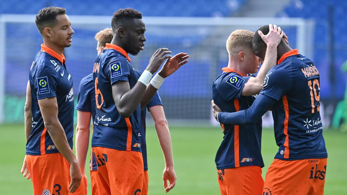 Montpellier's English forward Stephy Mavididi (R) is congratulated by his teammate midfielder Florent Mollet (2ndR) after scoring a goal during the French L1 football match between Montpellier HSC and Stade Rennais F.C
