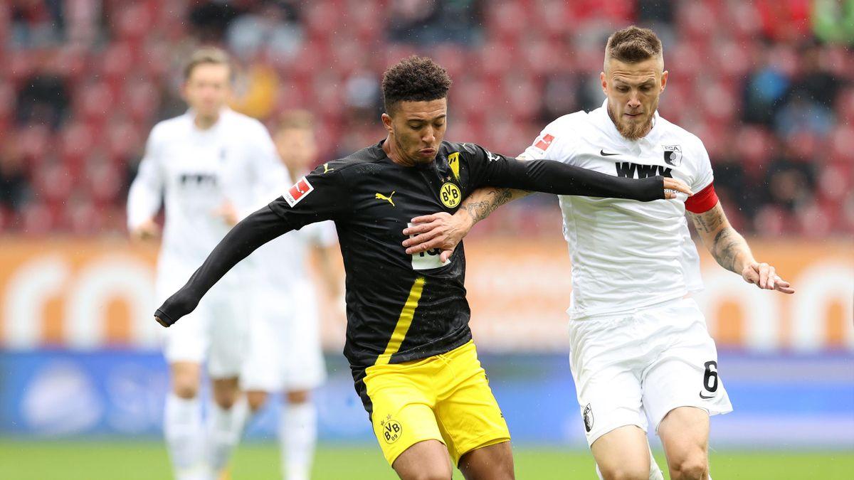 Jadon Sancho of Borussia Dortmund battles for possession