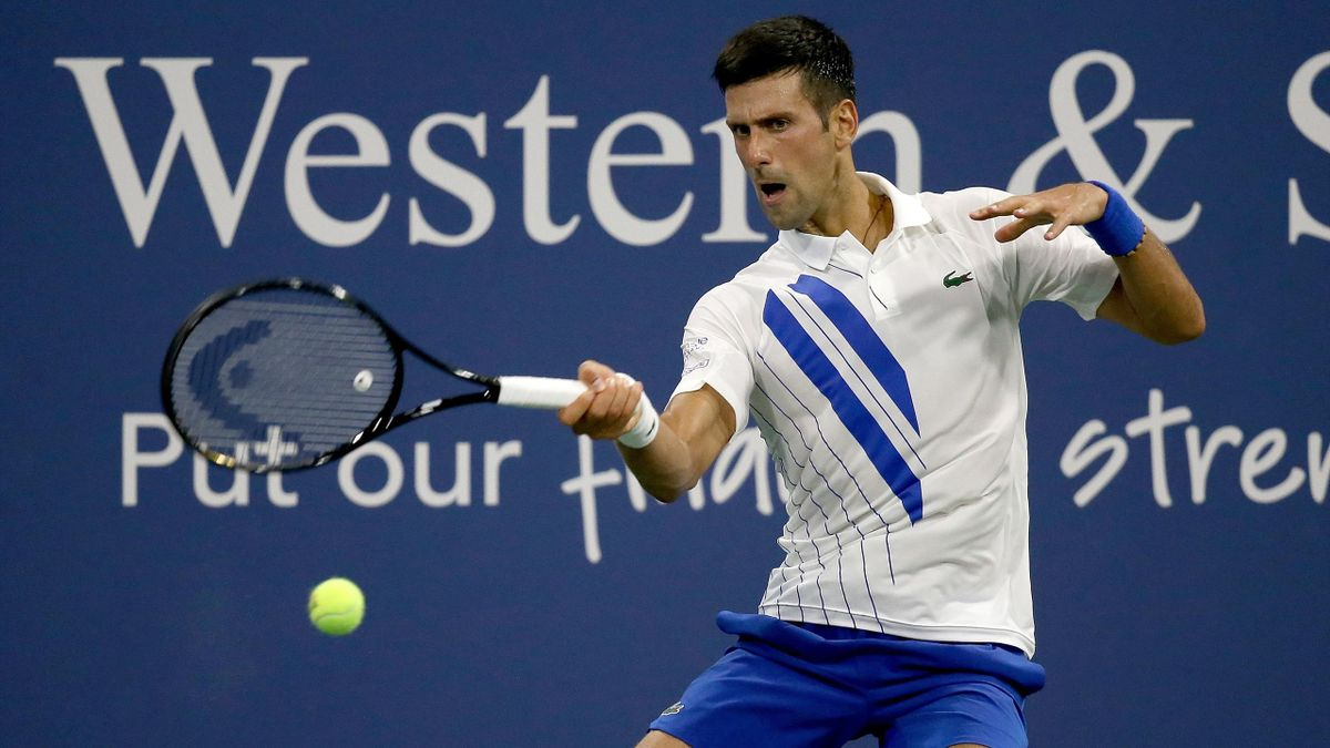 Novak Djokovic of Serbia returns a shot at the Western & Southern Open