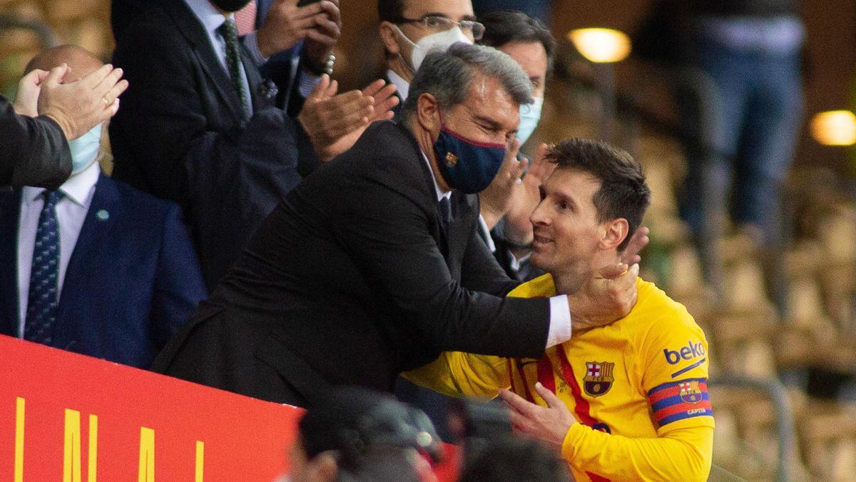 Joan Laporta (left) and Lionel Messi - FC Barcelona
