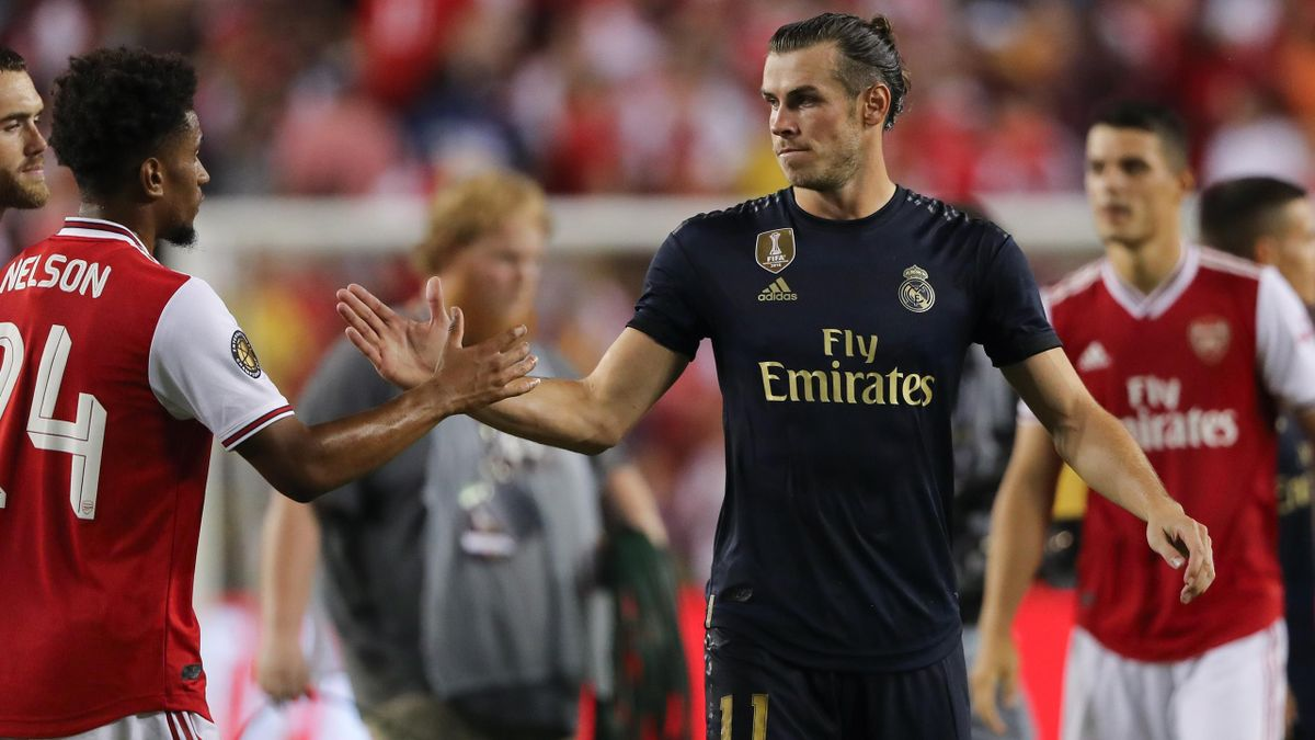 Reiss Nelson of Arsenal and Gareth Bale of Real Madrid during the International Champions Cup fixture between Real Madrid and Arsenal