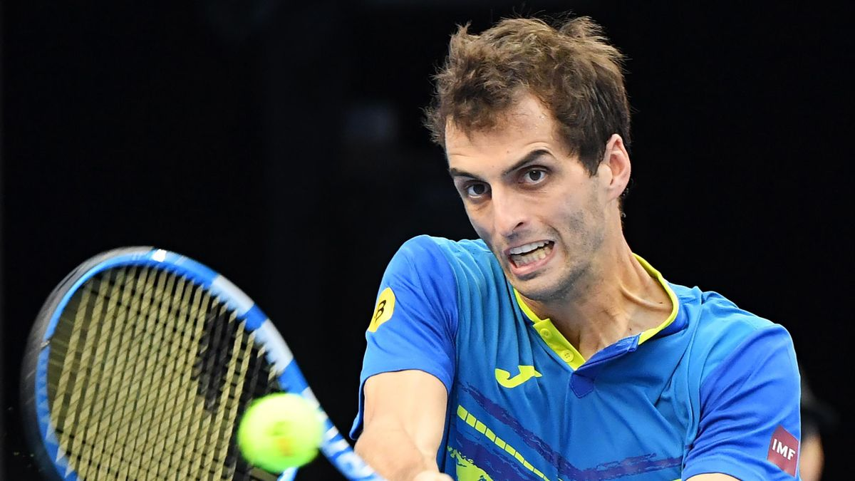 Albert Ramos-Vinolas of Spain hits a return during his men's singles first round match against Juan Martin del Potro of Argentina at the China Open tennis tournament in Beijing on October 2, 2018.