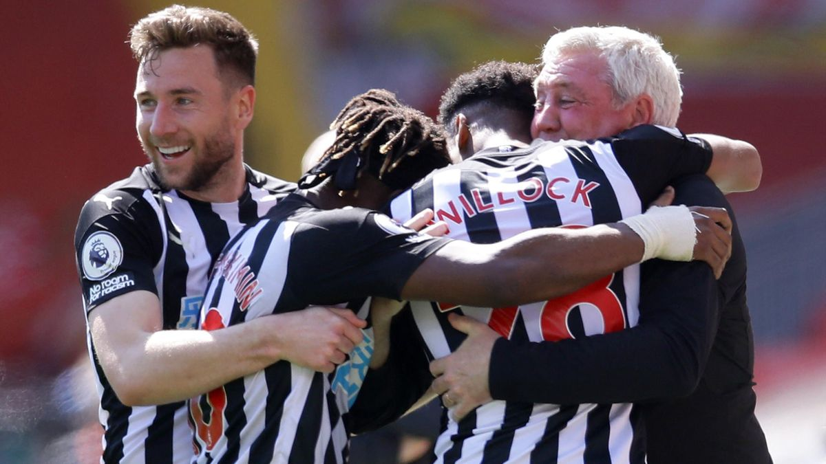 Newcastle players celebrate with Steve Bruce