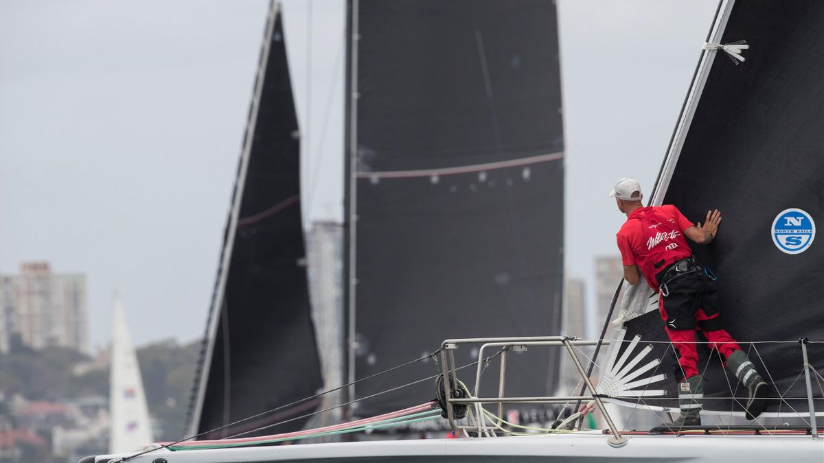 A crewman aboard the yacht Wild Oats XI stands on deck at the start of the annual 630 nautical miles (1166 kilometres) Sydney to Hobart Yacht Race