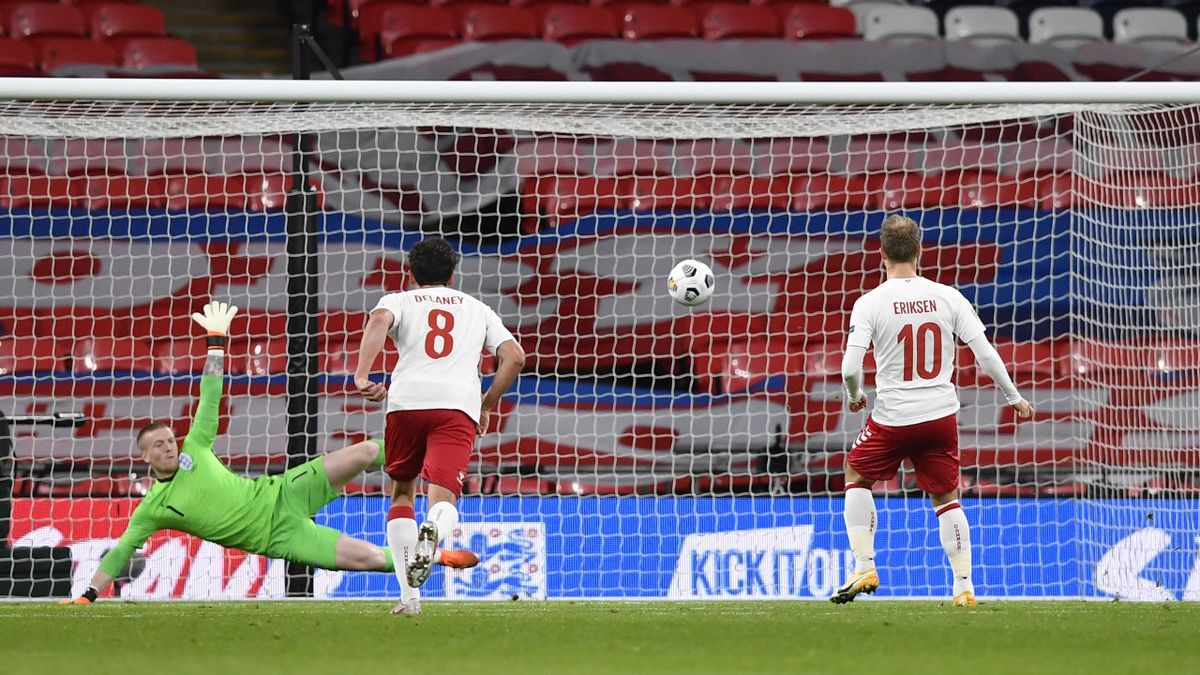 Christian Eriksen of Denmark scores his team's first goal from the penalty spot past Jordan Pickford of England during the UEFA Nations League group stage match between England and Denmark at Wembley Stadium on October 14, 2020 in London, England