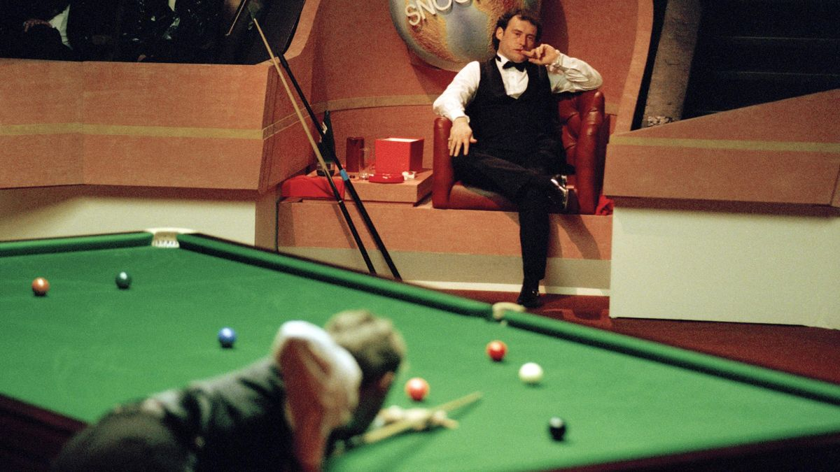 Jimmy White of England (seated) and Stephen Hendry of Scotland (playing) during the World Snooker Championship Final at the Crucible in Sheffield on 2nd May 1994. Hendry defeated White 18-17.