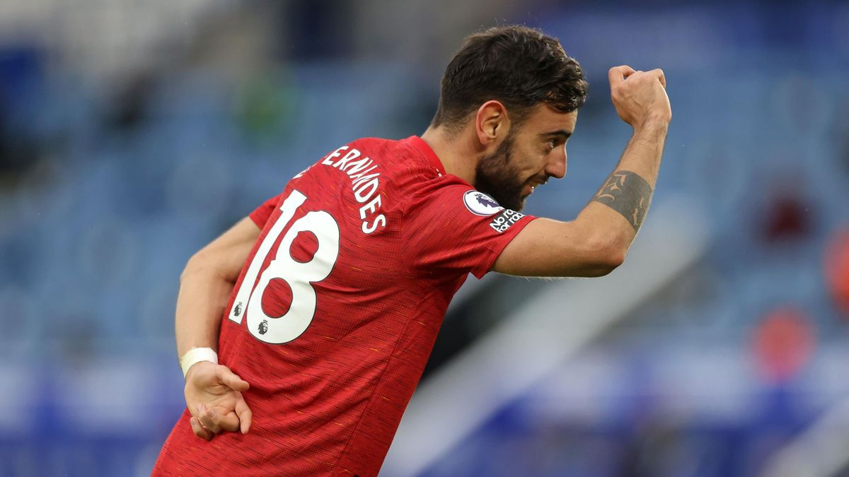 Manchester United's Portuguese midfielder Bruno Fernandes celebrates after scoring their second goal during the English Premier League football match between Leicester City and Manchester United at King Power Stadium in Leicester, central England on Decem