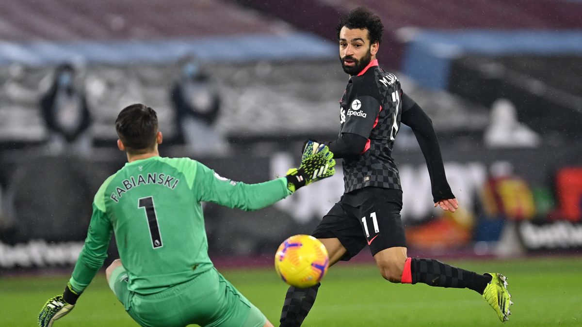 Mohamed Salah of Liverpool scores their side's second goal past Lukasz Fabianski of West Ham United during the Premier League match between West Ham United and Liverpool at London Stadium on January 31, 2021 in London, England