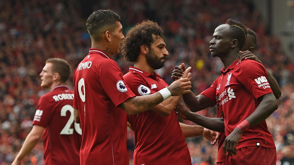 Liverpool's Senegalese striker Sadio Mané (R) celebrates with teammates