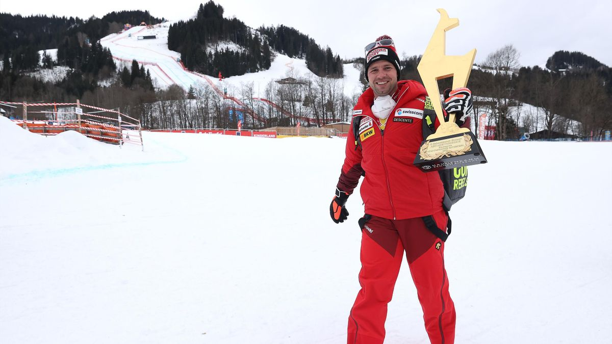 """Beat Feuz of Switzerland walks away from the slope with the """"Golden Chamois"""" winners trophy after winning the Audi FIS Alpine Ski World Cup Men's Downhill Hahnenkamm Rennen at Streif, Kitzbuehel, Austria, January 22, 2021"""