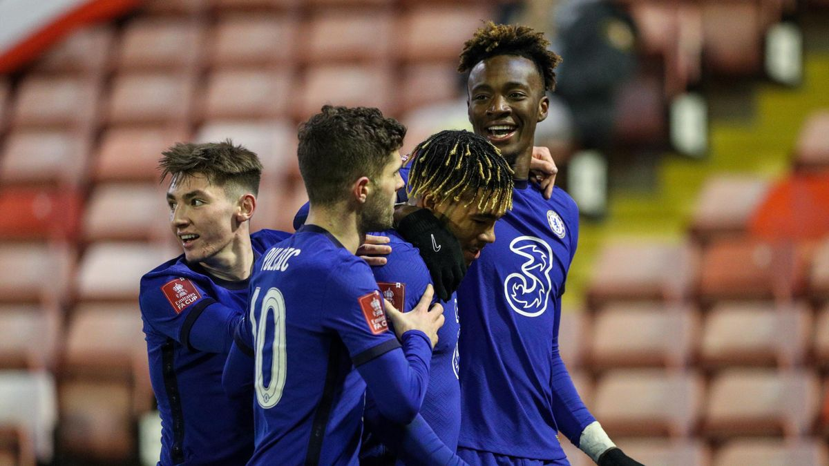 Chelsea's Tammy Abraham celebrates scoring the opening goal with Reece James during the Emirates FA Cup Fifth Round match between Barnsley and Chelsea at Oakwell Stadium on February 11, 2021 in Barnsley, England.