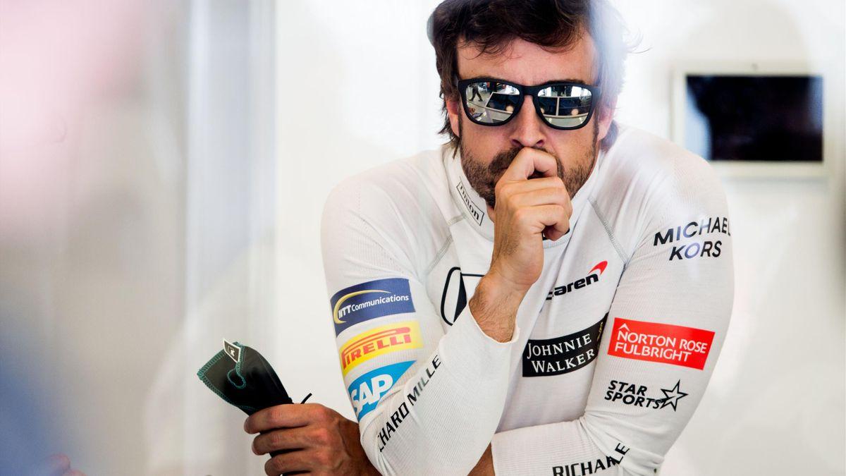 Fernando Alonso looks pensive