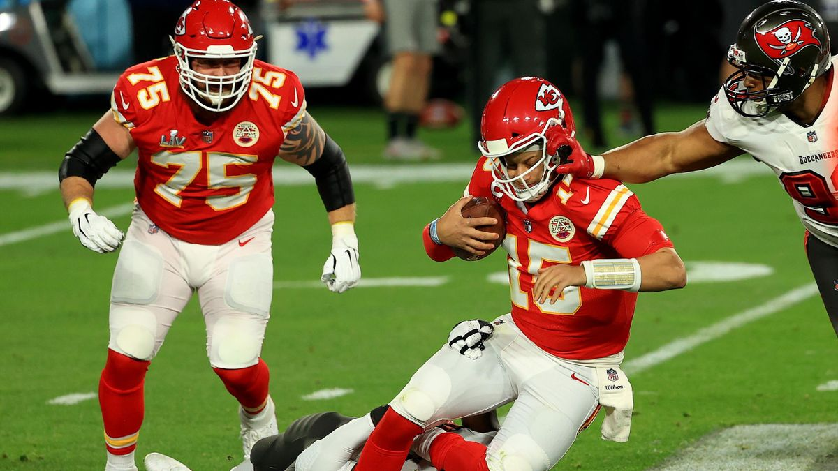 Patrick Mahomes #15 of the Kansas City Chiefs is tackled by Shaquil Barrett #58 of the Tampa Bay Buccaneers