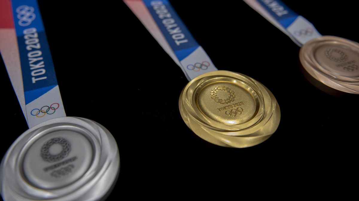 The silver, gold and bronze medals are unveiled in the Tokyo 2020 medal design unveiling ceremony