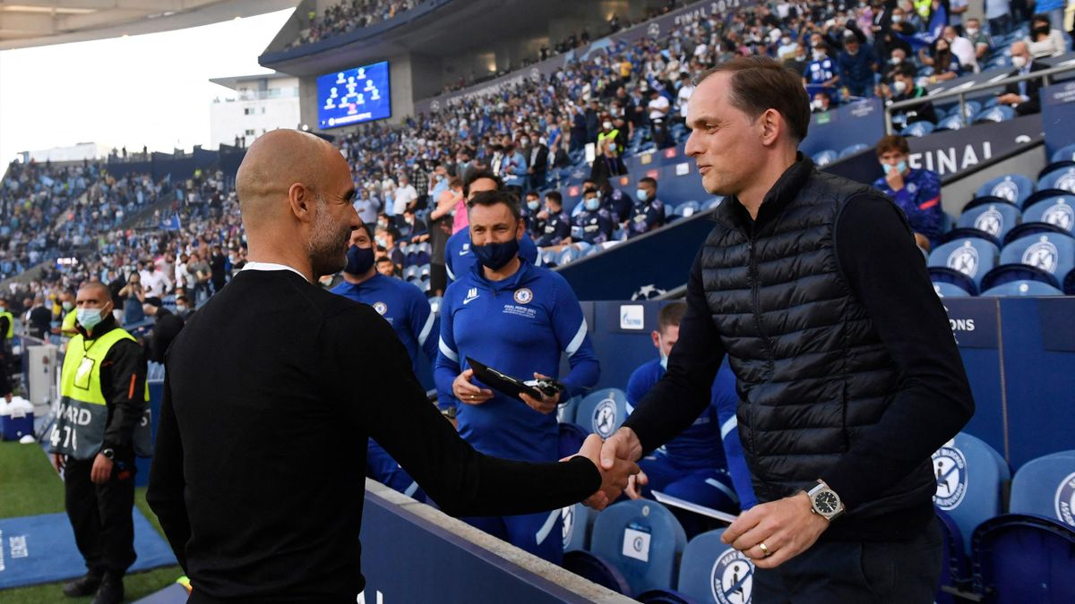 Manchester City's Spanish coach Josep Guardiola (L) greets Chelsea's German coach Thomas Tuchel ahead of the UEFA Champions League final football match between Manchester City and Chelsea