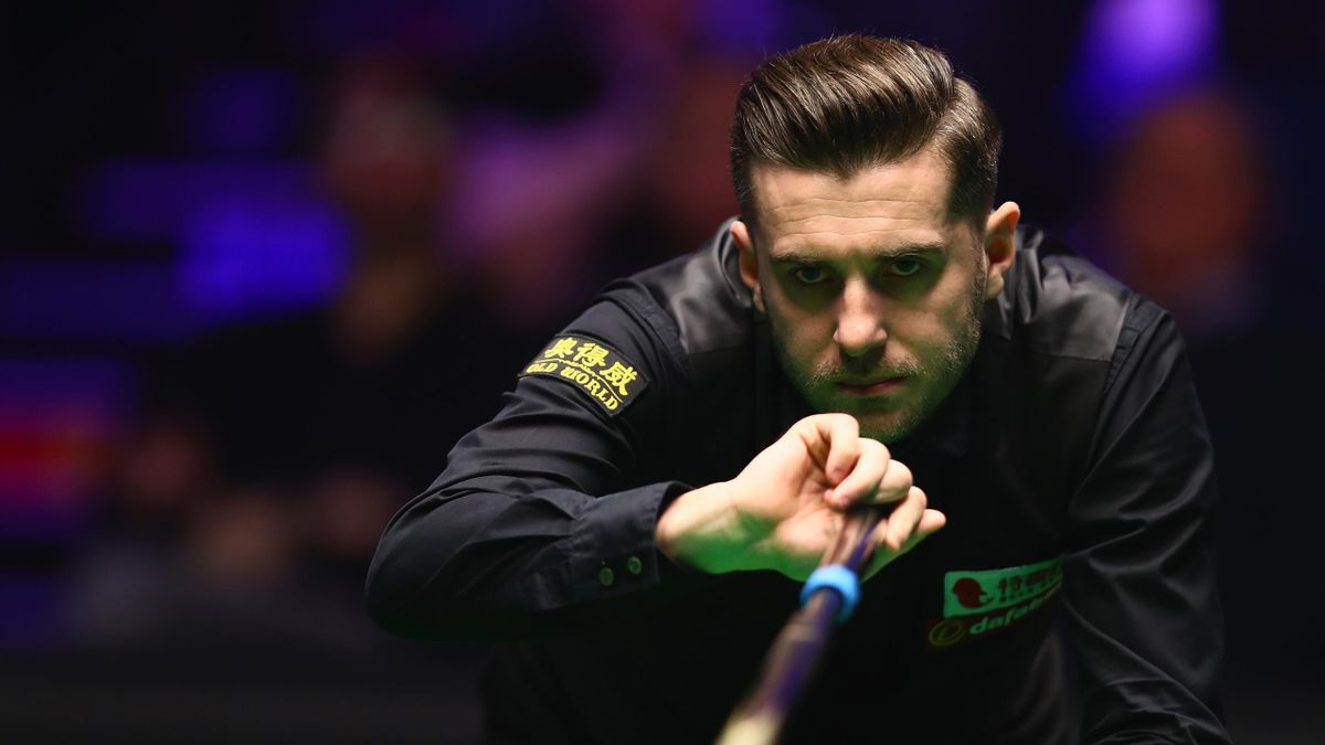 Mark Selby of England plays a shot during his match against Mark Williams of Wales on day one of The Dafabet Masters at Alexandra Palace on January 14, 2018 in London, England