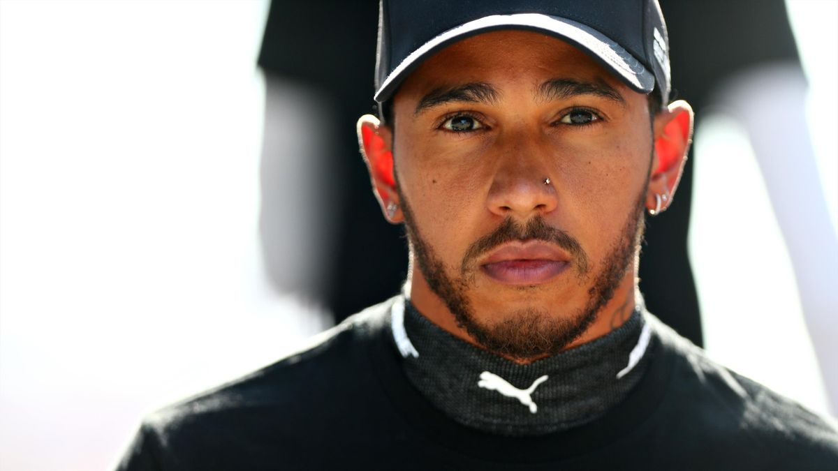 Lewis Hamilton of Great Britain and Mercedes GP looks on before the F1 Grand Prix of Russia at Sochi Autodrom