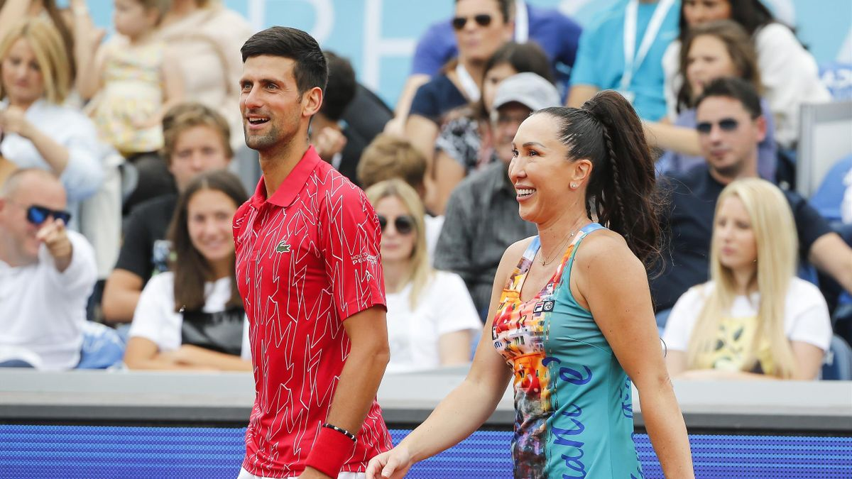 Novak Djokovic (L) and Jelena Jankovic (R) smile during a tennis doubles match against Nenad Zimonjic and Olga Danilovic at a charity tournament prior to the Adria Tour tennis event, in Belgrade, Serbia, Friday, June 12, 2020