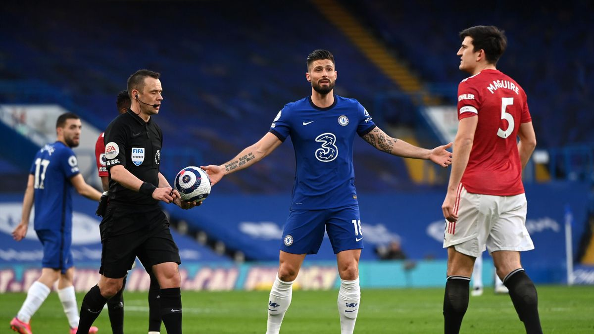 Harry Maguire of Manchester United and Olivier Giroud of Chelsea interact with Match Referee, Stuart Attwell after a VAR decision during the Premier League match between Chelsea and Manchester United at Stamford Bridge on February 28, 2021 in London, Engl