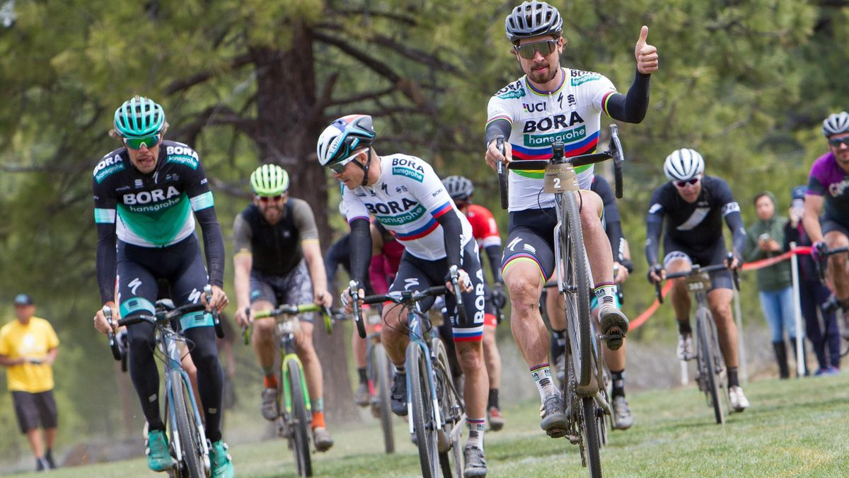 Peter Sagan of Slovenia riding for the Bora Hansgrohe team wheelies as he crosses the finish line of the Sagan Fondo
