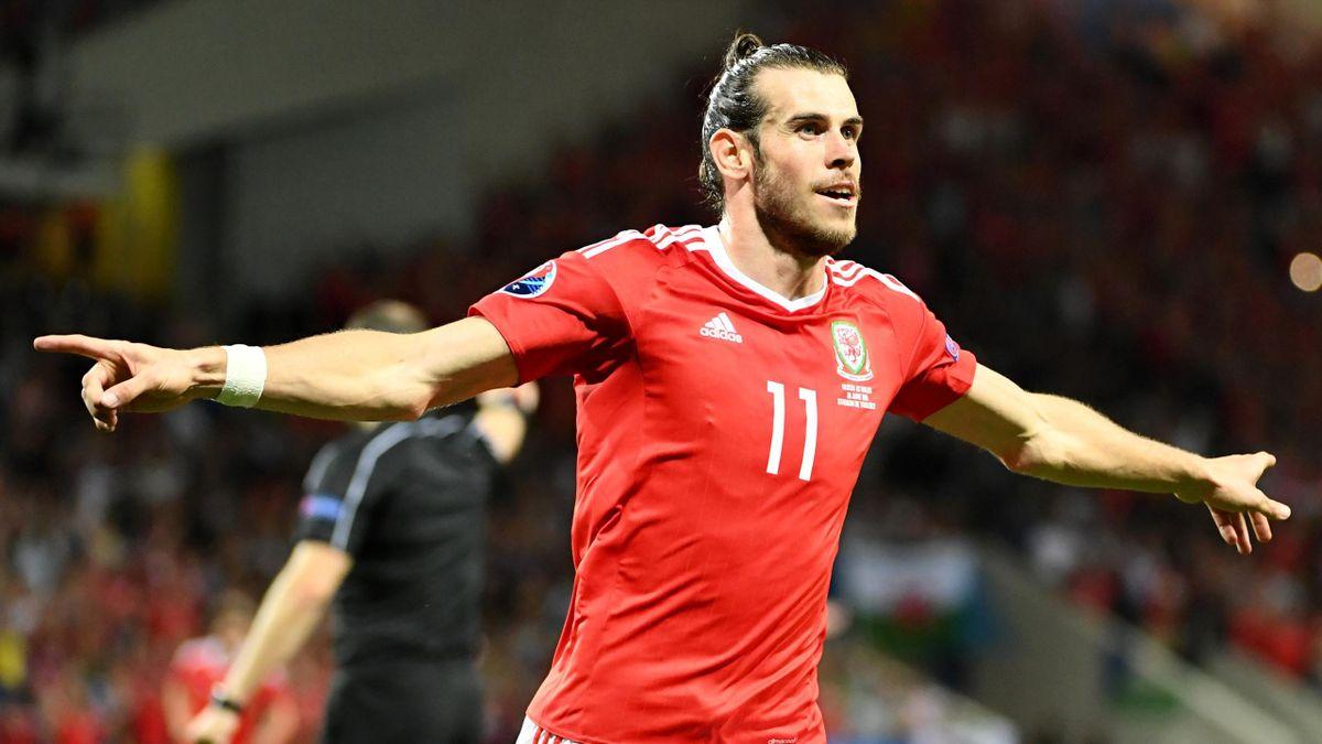 Gareth Bale celebrates scoring the team's third goal during the Euro 2016