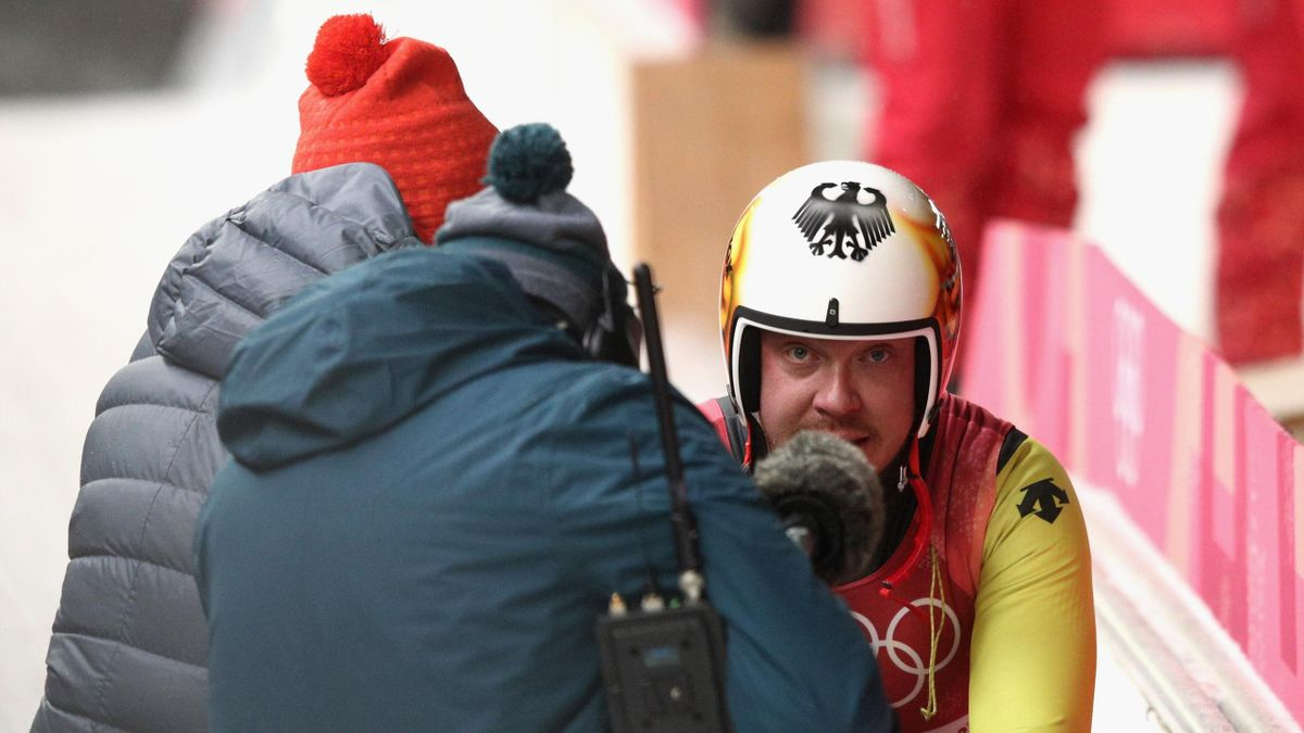 Felix Loch of Germany is consoled by his father Norbert Loch after finishing overall fifth following run 4 during the Luge Men's Singles on day two of the PyeongChang 2018 Winter Olympic Games at Olympic Sliding Centre on February 11, 2018 in Pyeongchang-
