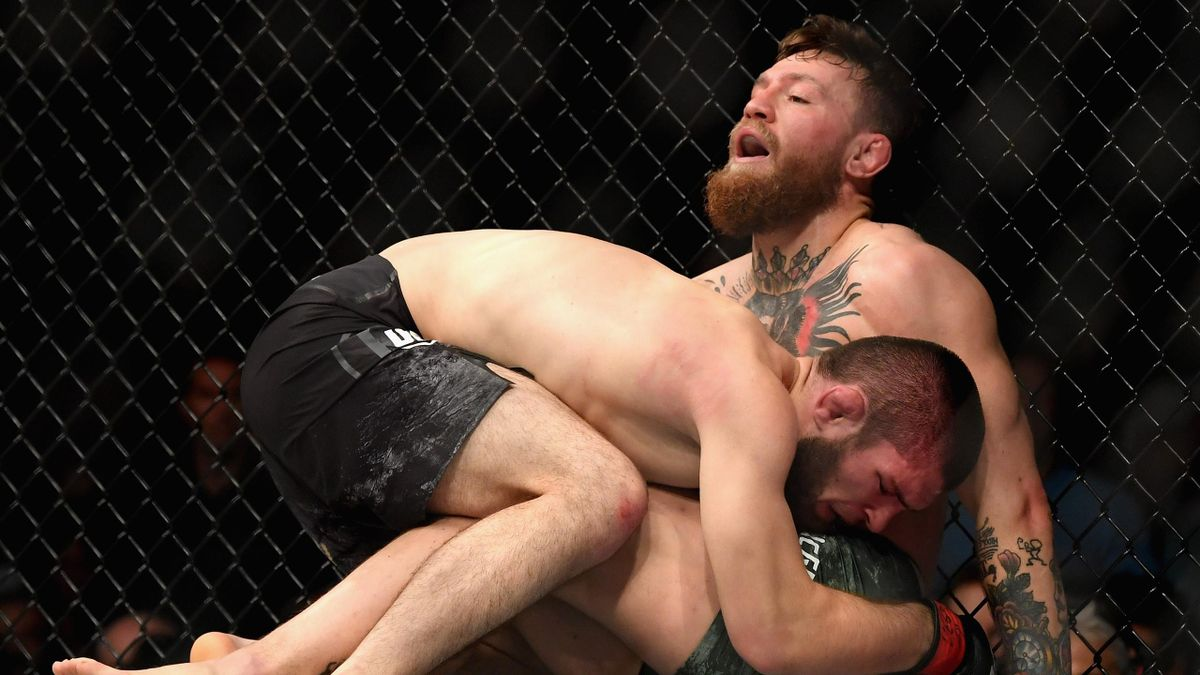 Khabib Nurmagomedov of Russia holds down Conor McGregor