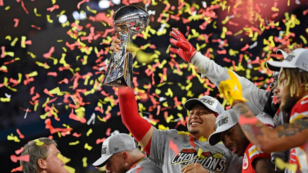 Kansas City Chiefs' quarterback Patrick Mahomes (15) holds up the Vince Lombardi Trophy after winning Super Bowl LIV