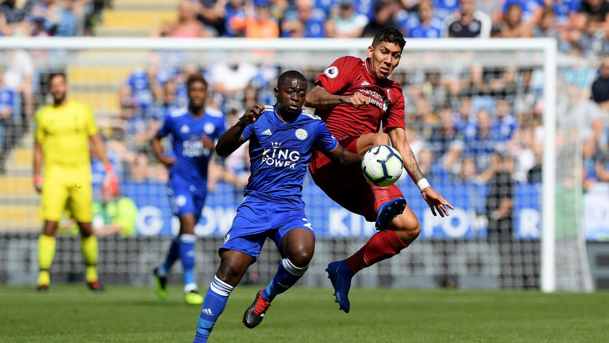 Roberto Firmino of Liverpool battles with Nampalys Mendy of Leicester City during the Premier League match between Leicester City and Liverpool FC at The King Power Stadium on September 1, 2018 in Leicester, United Kingdom