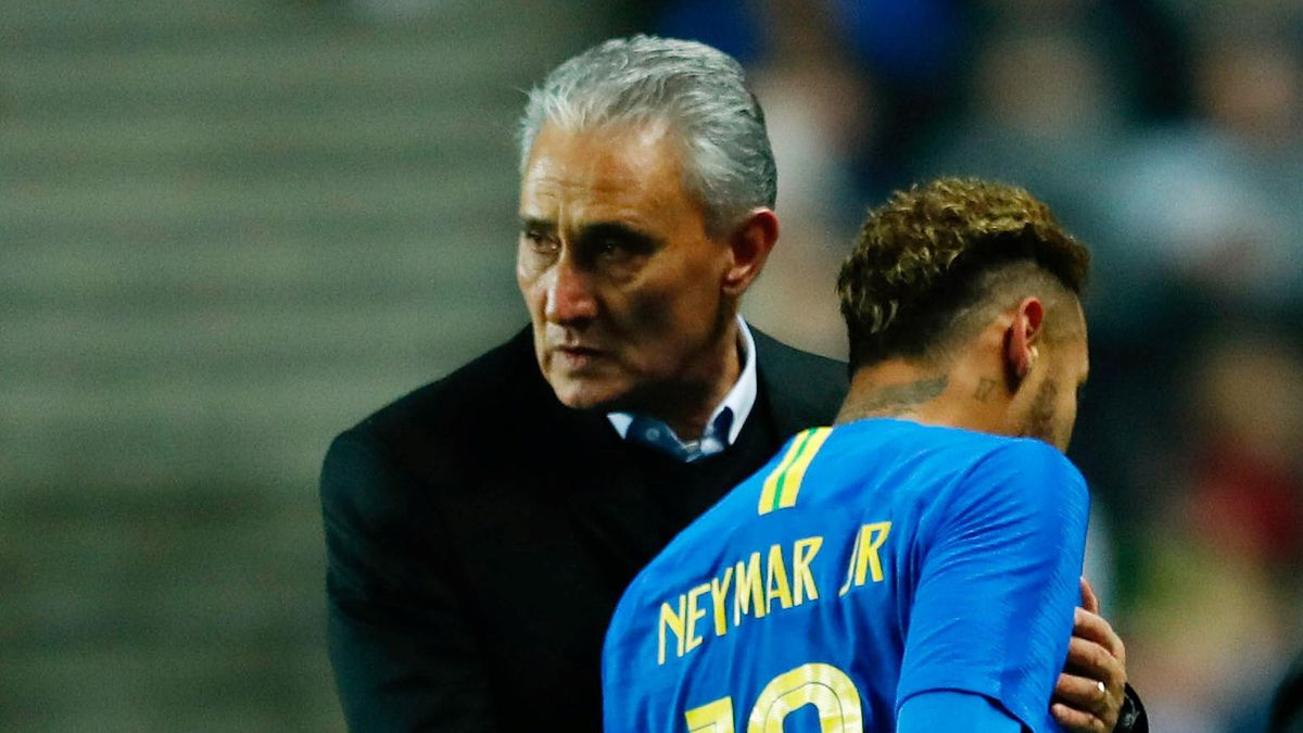 Brazil's Neymar leaves the pitch after sustaining an injury as Brazil coach Tite looks on