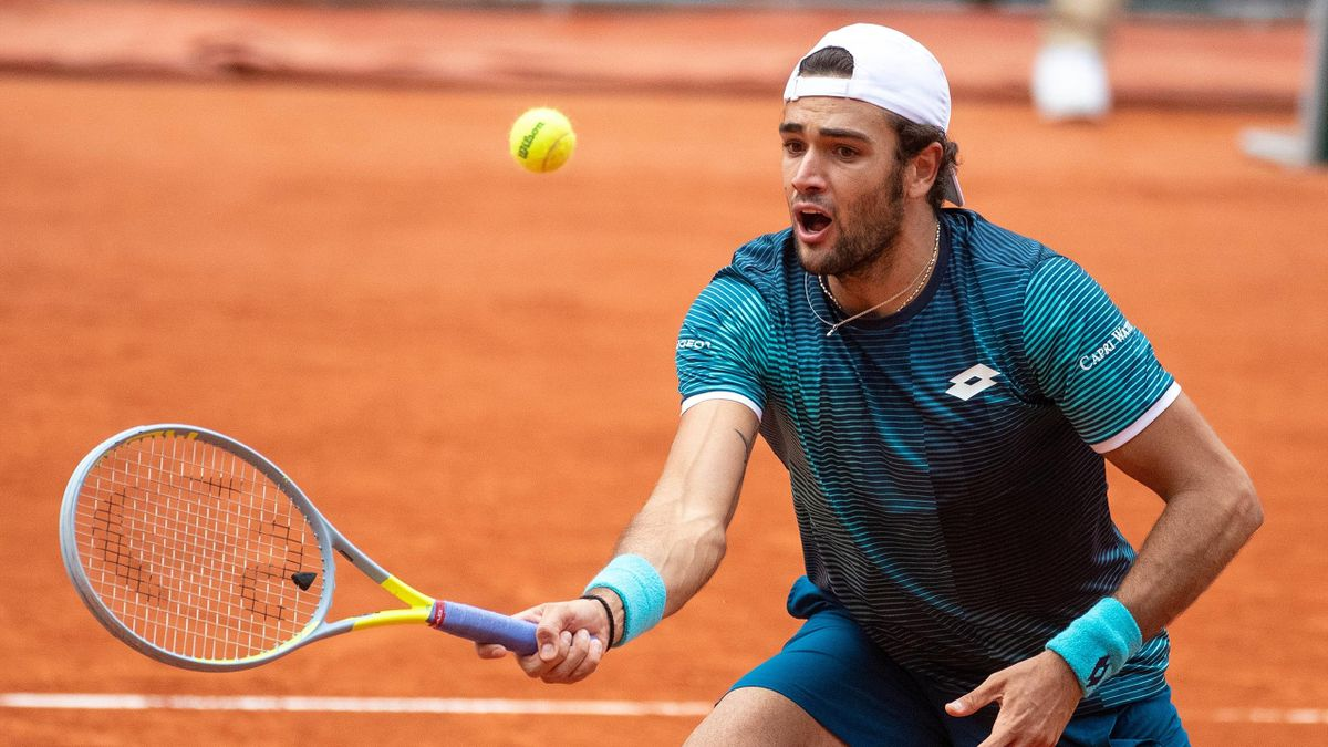 Matteo Berrettini of Italy reacts in action against Daniel Altmaier of Germany in the third round of the singles competition on Court Philippe-Chatrier during the French Open Tennis Tournament at Roland Garros