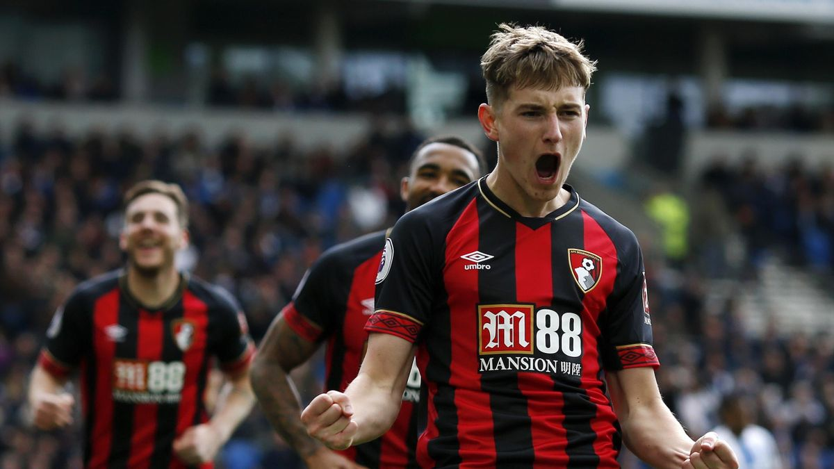 : David Brooks of AFC Bournemouth celebrates after scoring his team's third goal during the Premier League match between Brighton & Hove Albion and AFC Bournemouth at American Express Community Stadium on April 13, 2019 in Brighton