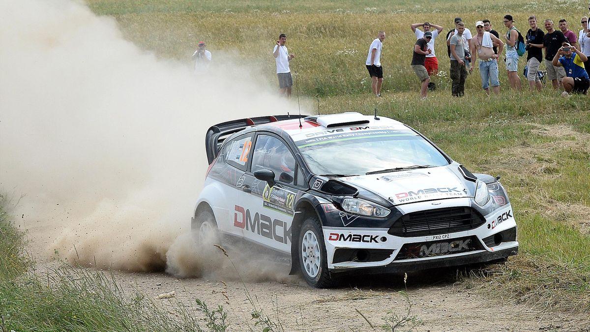 Estonian driver Ott Tanak and his compatriot co-driver Raigo Molder drive their Ford Fiesta RS WRC
