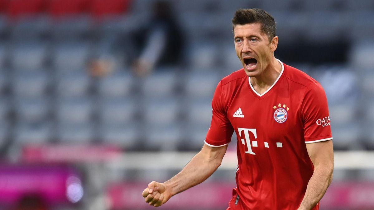 Bayern Munich's Polish forward Robert Lewandowski celebrates scoring the opening goal during the German first division Bundesliga football match FC Bayern Munich vs Hertha Berlin on October 4, 2020 in Munich, southern Germany. (Photo by CHRISTOF STACHE /