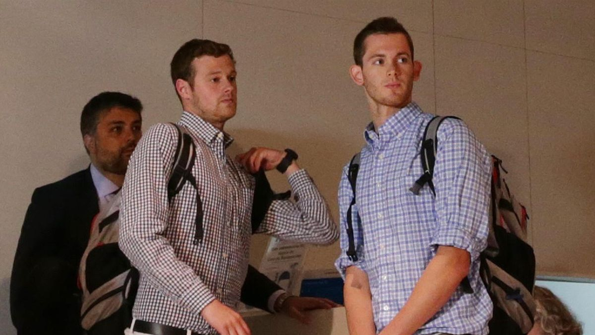 U.S. Olympic swimmers Jack Conger and Gunnar Bentz check in at the international airport to board a flight back to the U.S. after spending the day being interrogated by police in Rio de Janeiro, August 18, 2016