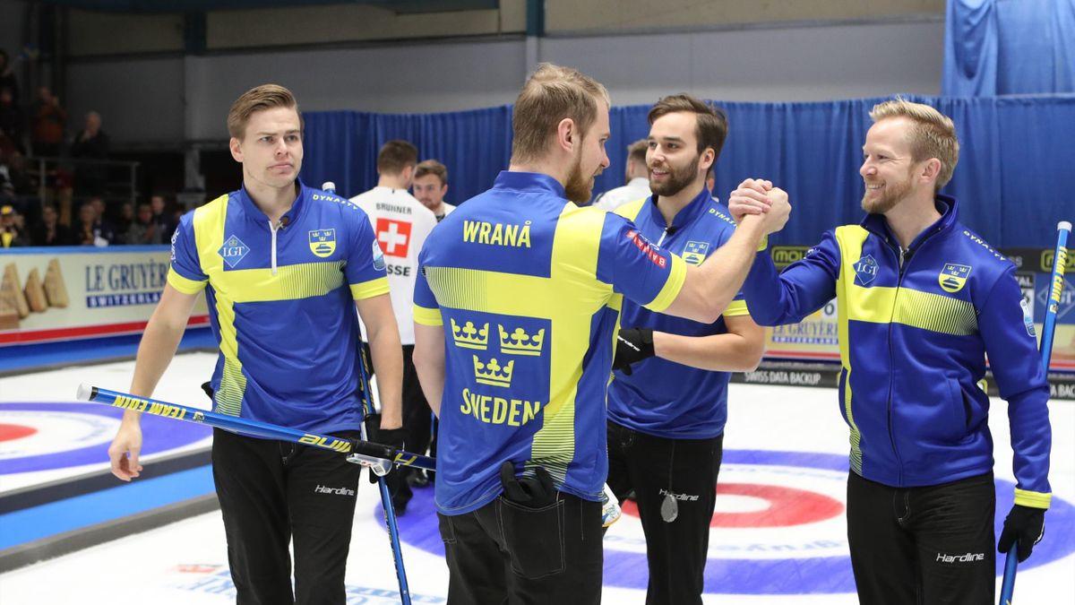 Team Edin celebrate their gold (@World Curling)
