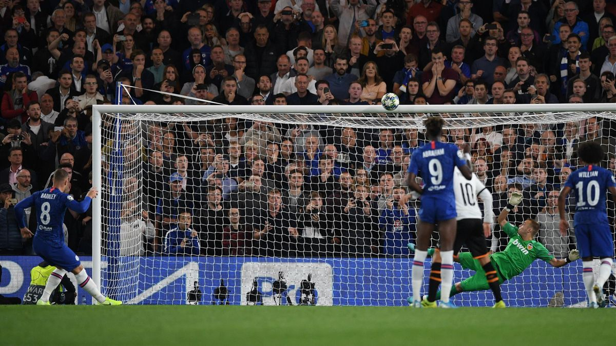 Chelsea's English midfielder Ross Barkley (L) hits a penalty over the bar during the UEFA Champion's League Group H football match between Chelsea and Valencia at Stamford Bridge in London on September 17, 2019.