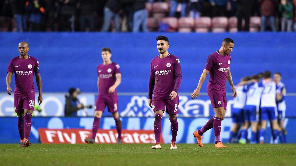 La joie des joueurs de Wigan contraste avec la déception de ceux de City.